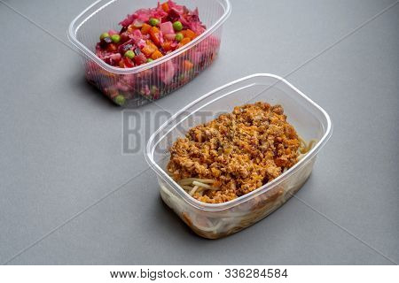 Pasta With Minced Meat And Onion In Navy-style And A Jar Of Vinaigrette On A Gray Background.