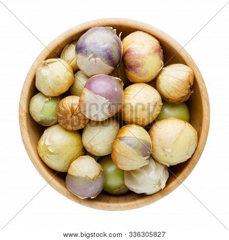 Ripe Tomatillo (mexican Husk Tomato, Physalis Philadelphica, Vegetable Physalis) In Wooden Bowl Isol