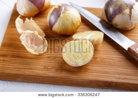 Ripe Tomatillo (mexican Husk Tomato, Physalis Philadelphica, Vegetable Physalis) On Cutting Board.
