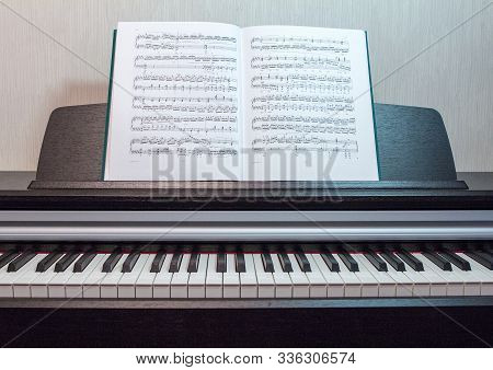 2018.09.18, Moscow, Russia. An Open Book Of Sheet Music On The Piano. A Composition Of The Sheet Mus