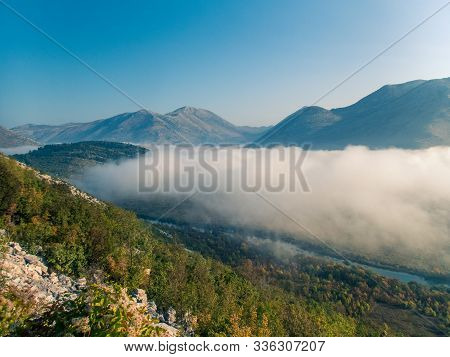 Stock Photo Of Green Mountains With Fog In The Middle Of The Valley. Croatia. Travel Concept