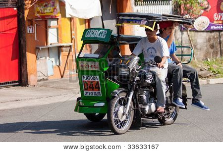 Asia tricycle cab driver