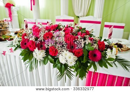 Beautiful Wedding Set Decoration In The Restaurant. Flowers On Table Of Newlywed.