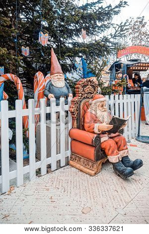 PARIS, FRANCE - DECEMBER 5, 2018: Santa Claus decoration at the Tuileries Garden Christmas Market in Paris