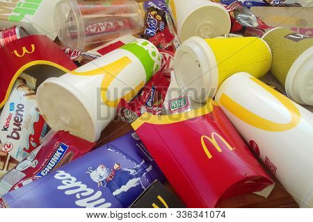 Many Used Food Wrappings And Drink Cans By Random Food Manufacturing Famous Brands. Recycled Trash O