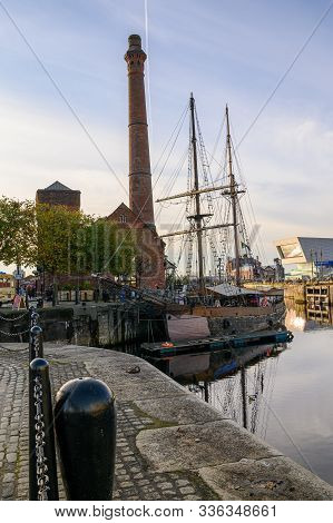 The Pump House And A Tall Ship In Canning Dock, Liverpool. Part Of The Redevelopment Of The Albert D