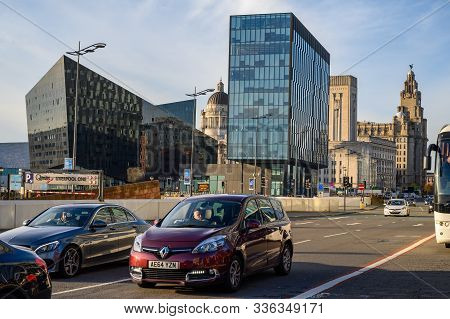 Uk, Liverpool - November 10, 2019: Traffic Passing The Modern Office Buildings Surrounding The Canni