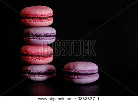 Macaroons On Dark Background, Colorful French Cookies Macaroons. Macaroons