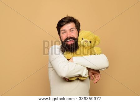 Man Holds Teddy Bear Plush Toy. Smiling Man Hugs Teddy Bear. Holiday Celebration. Birthday Or Annive