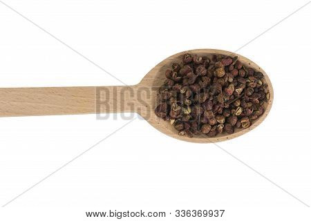 Sichuan Pepper In Wooden Spoon Isolated On White Background. Spices And Food Ingredients. Spices And