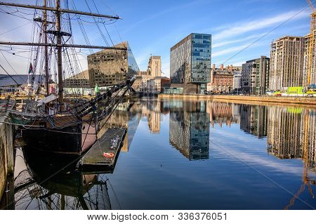 Tall Ship And Modern Office Buildings Surrounding Canning Dock Redevelopment In Liverpool. Beautiful