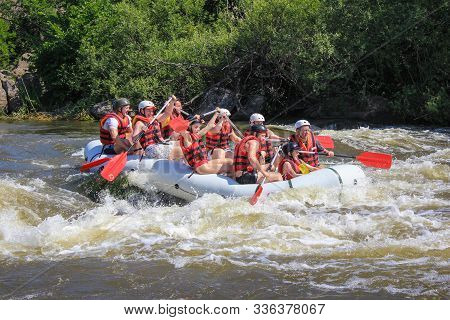 Pacuare River,  Costa Rica - March 14 2019: Rafting Team , Summer Extreme Water Sport.  Group Of Peo