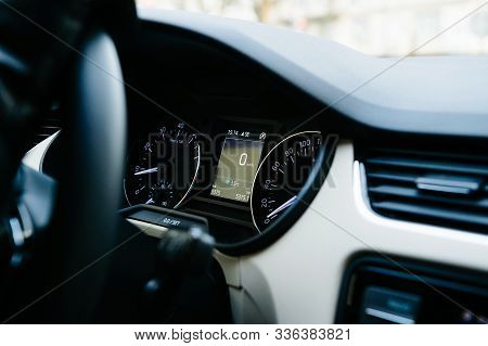 Interior View Of Modern Luxury Car With Analog And Digital Speed Limit Clock And Zero Kilometers On