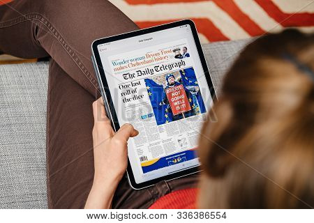Paris, France - Jun 2, 2019: Overhead View Of A Woman Reading On On Apple News App On Ipad Tablet Th