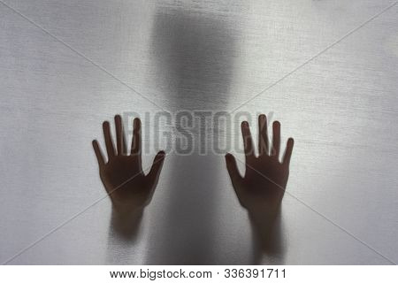 No Focus. The Fabric Behind Her. Silhouette And Shadow. Child With His Hand Against The Fabric, Plea