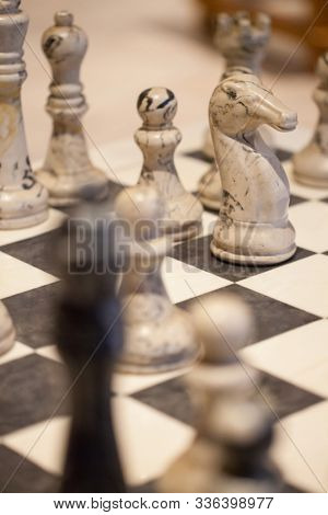 vintage lomo look of a chess table with marble chess pieces,