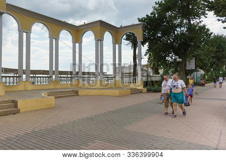Yevpatoria, Crimea, Russia-september 07, 2019: People With A Lot Of Weight Walk Along The Gorky Emba