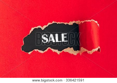 Wors Sale On Black Background Under Torn Red Paper. Mockup, Copy Space.