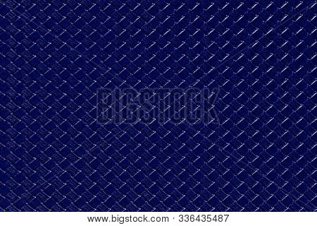 Navy blue leather background with imitation weave texture. Glossy dermantine, artificial leather structure. Fake woven leather wicker textured surface. poster