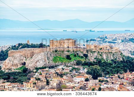 View Of The Acropolis Of Athens (in Greece) With Filopappos Hill, The Saronic Gulf And The Port Of P
