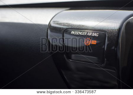 Passenger Airbag Status Warning Light On Display Of A Car Console.