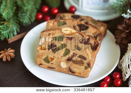 Sweet Christmas Fruit Cake Slices On White Plate Put On Black Granite Table In Side View Copy Space