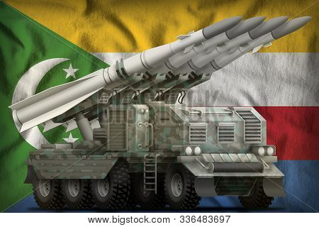 Tactical Short Range Ballistic Missile With Arctic Camouflage On The Comoros Flag Background. 3d Ill