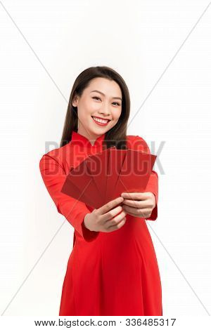 Pretty Women With Ao Dai, In Lunar New Year A Red Packet Is A Monetary Gift