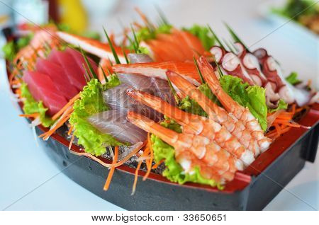 Sashimi Seafood Set In A Boat Blow