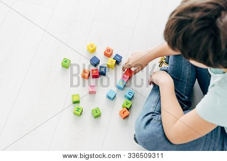 Cropped View Of Kid With Dyslexia Playing With Colorful Building Blocks
