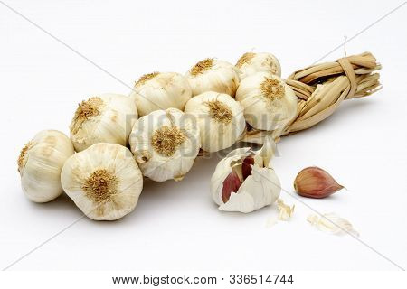Garlic Plait, String Of Garlic Bulbs With Pods In The Foreground
