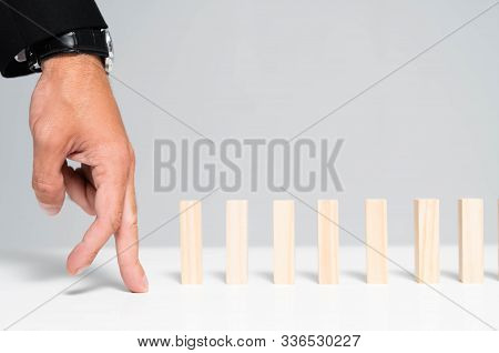 Cropped View Of Man Showing Tiptoe Gesture Near Wooden Blocks Isolated On Grey