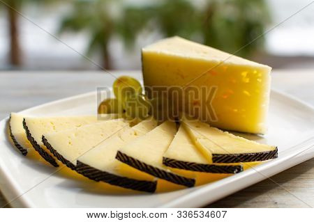 Spanish Sheep Cheese Served With White Grapes Outside With Sea View