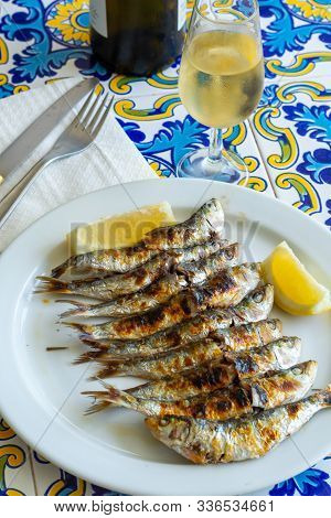 Espeto, Malaga Style Fish On Stick Barbecue Prepared On Olive Tree Firewoods Served With Dry Fino Sh