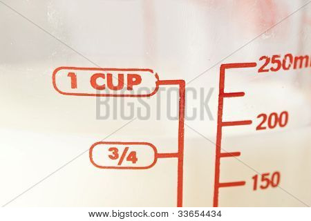 White Milk In A Measuring Cup