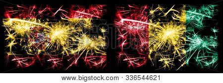 Spanish Vs Guinea, Guinean New Year Celebration Sparkling Fireworks Flags Concept Background. Combin