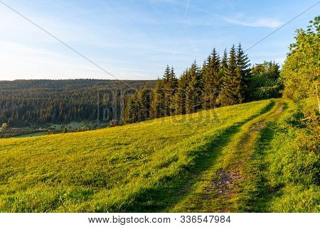 Narrow Path In The Meadow On Sunny Summer Evening. Scenic Natural Landscape Of Jizera Mountains