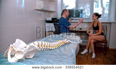 Chiropractic Treatment - The Doctor Inspecting The Young Woman Before The Session - Model Of The Hum