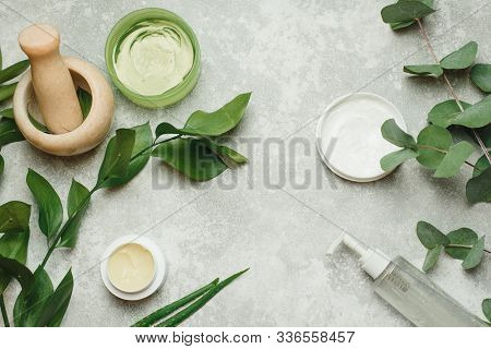 Flat Lay Composition With Cosmetic Products On Grey Background. Natural Organic Botany , Alternative