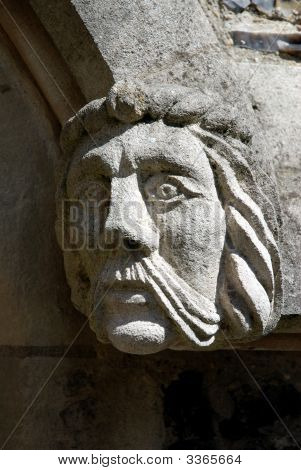 Stone Face On 9Th Century Abbey Wall