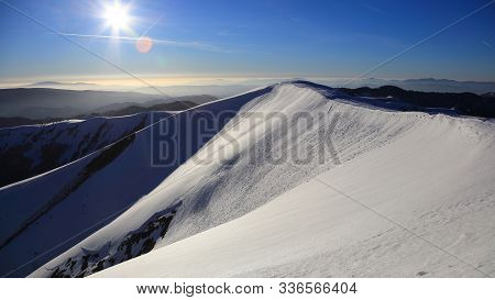 Snow Covered Mountain Ridge With Small Avalanche On Its Side During Cold Sunny Day, Fatra, Slovakia