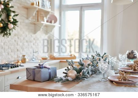 Interior Light Kitchen With Christmas Decor And Tree. White Kitchen In Classic Style. Christmas In T