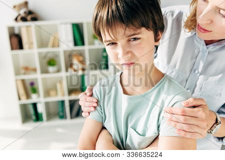 Cropped View Of Child Psychologist Hugging Kid With Dyslexia