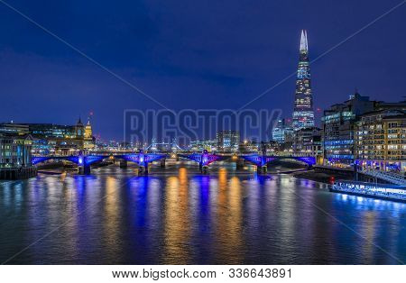 City Skyline After Sunset With The Shard, Southwark Bridge And Tower Bridge Across Thames River With