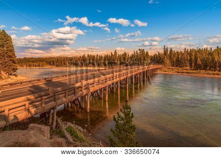Historic Fishing Bridge Over Yellowstone River At Sunset. Yellowstone National Park. Wyoming. Usa