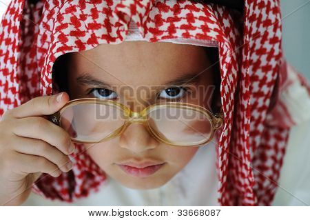 Arabic little kid boy with Magnifying glass