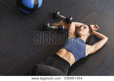 Upper Angle Dreamy Sensual Young Sportswoman With Six-pack, Perfect Body Shape, Lying On Rubber Mat