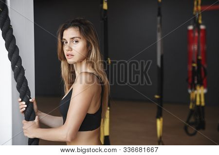 Focused, Motivated Healthy Blond Sportswoman In Good Shape, Holding Black Battle Rope And Turn Camer