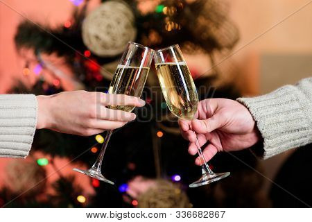 Cheers Concept. New Year Tradition. Merry Christmas. Almost Midnight. Alcohol Drink. Glass Filled Sp