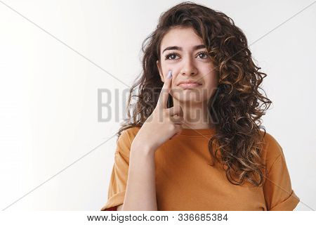 Sarcastic Cute Curly-haired Armenian Girl Hold Index Finger Camera Like Showing Teardrop Acting Upse